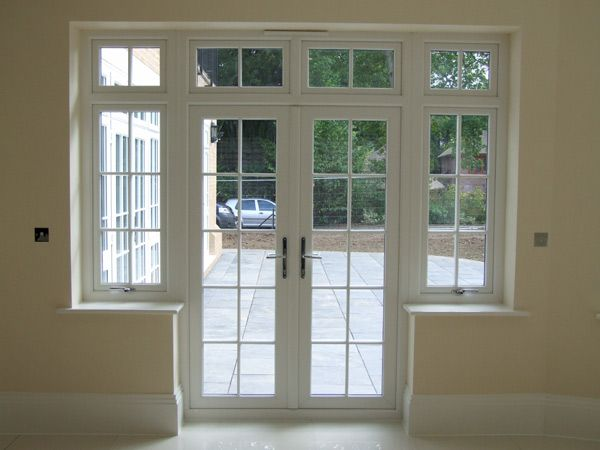 Pvc u french doors from carshalton woldingham and surrey for Double opening patio doors