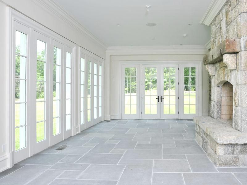 Sun Room With Fireplace And Stone Floor