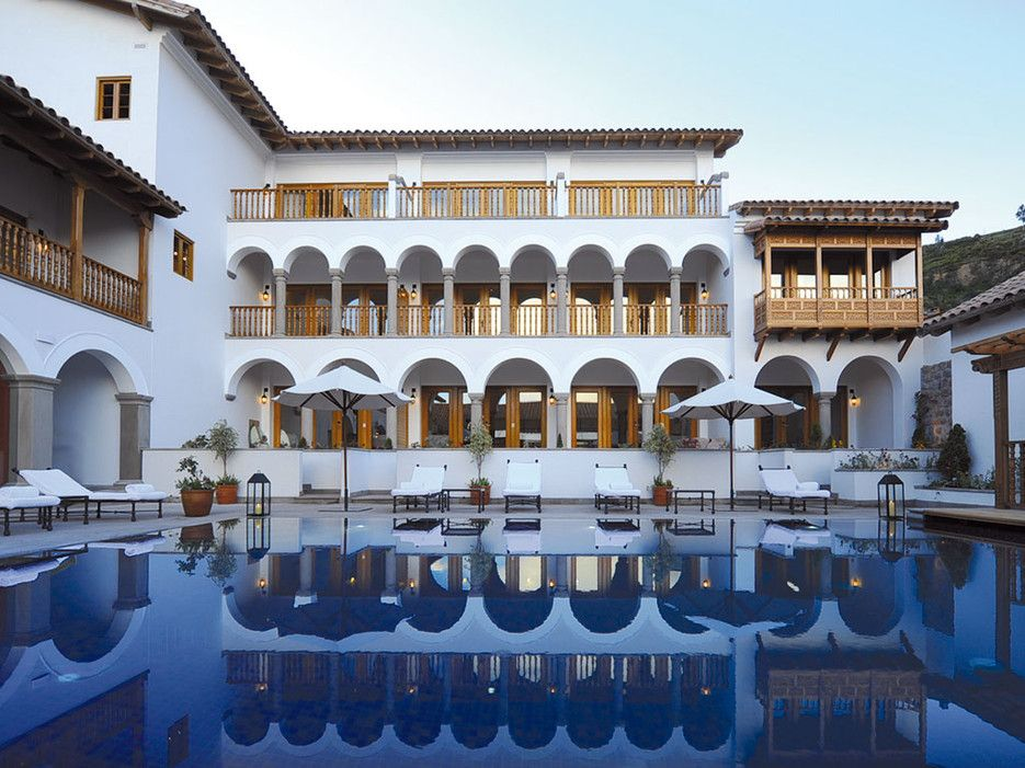 Readers' Rating: 87.917Belmond Palacio Nazarenas has 55 oxygen-enriched suites in a former palace built over Incan foundations, a short walk from the Plaza de Armas. The design is pure colonial grandeur—elaborately carved wood furniture, courtyards scented with herb gardens and crossed by ancient stone channels.