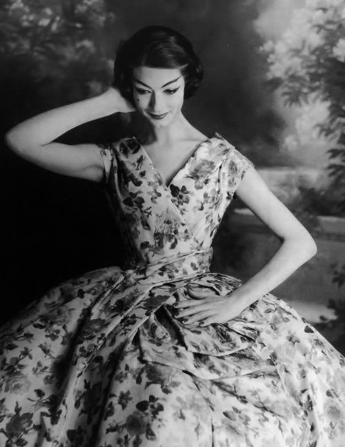 Model wearing a Christian Dior cocktail dress in white taffeta printed with flowers, 1956 <3