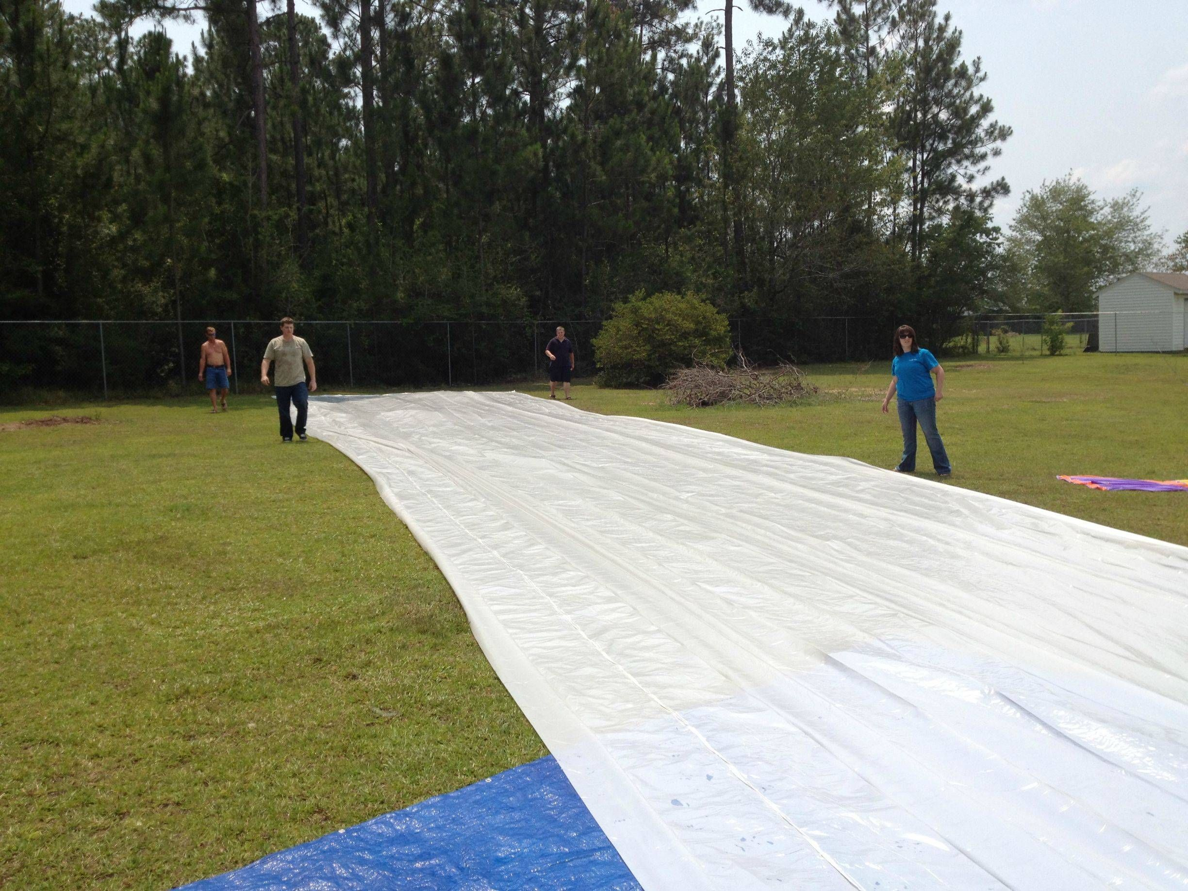 make a giant slip n slide - my dad would make one of these ...