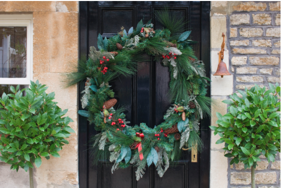 Door Christmas Wreath with natural foliage and red berries