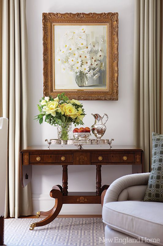 Fittingly, the owners display gleaming silver from their collection throughout. This reminds me of my Grandmother Kilgour's apartment. Love the subtle grays, different textures and the dark traditional furniture.