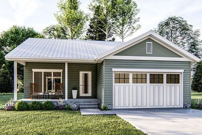 A standing seam metal roof shelters the entry porch of this one-bed tiny vacation cottage. Step inside and you enter an open floor plan with the bedroom tucked away in the back-right corner. The 2-car garage has access to the home by the kitchen and a side-by-side washer dryer is located in a closet with bi-fold doors.