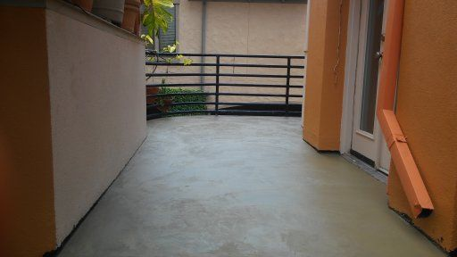 2nd Story Colored Concrete Patio For Houston Home.
