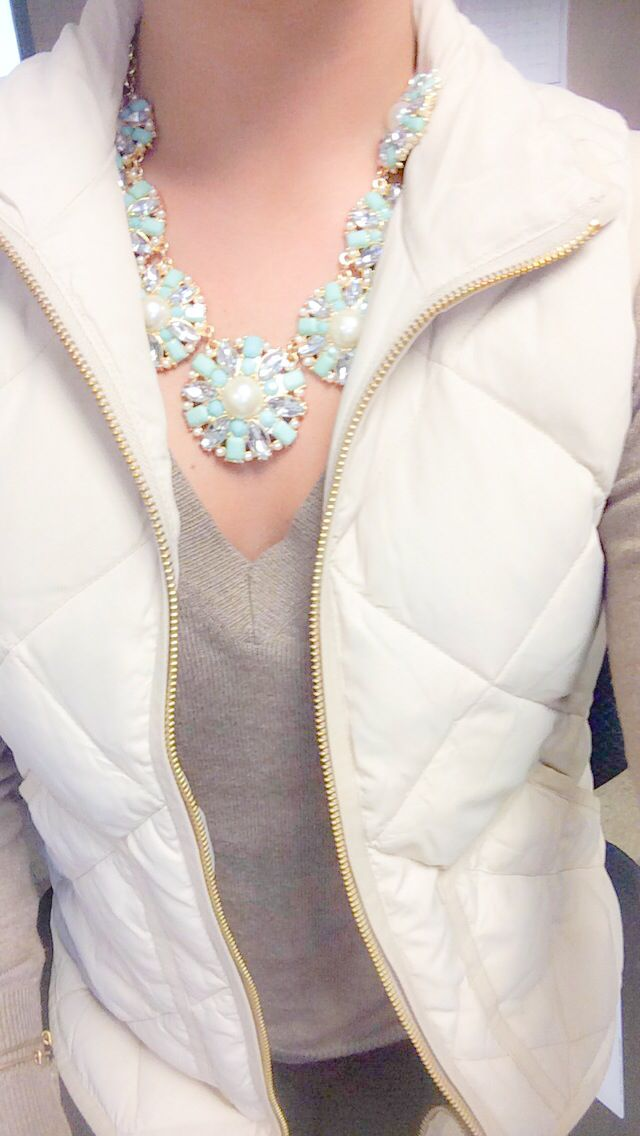 J. Crew quilted excursion vest and a statement necklace