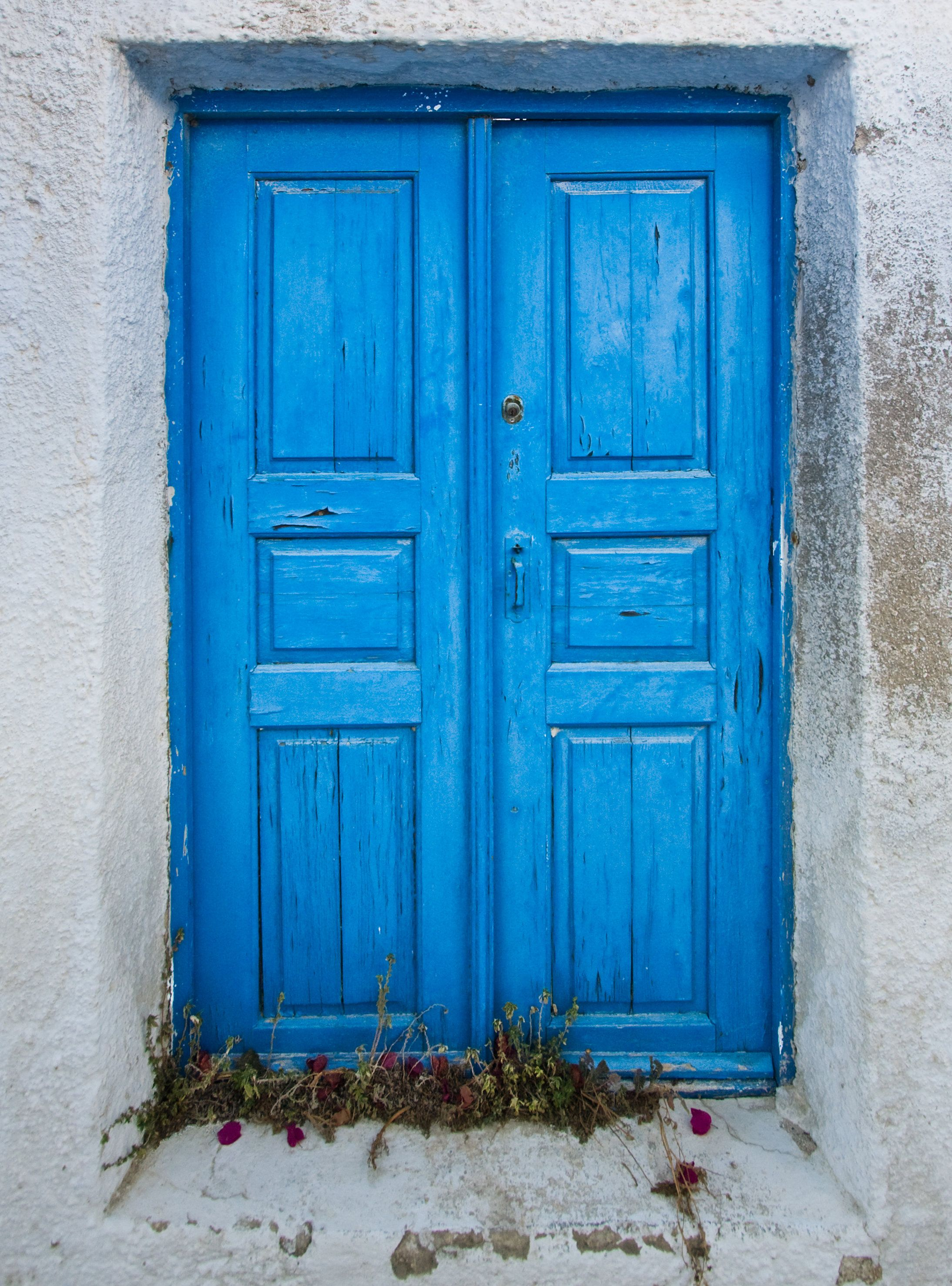 Bright Blue Shutters Give A Building A Mediterranean Feel