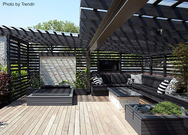 Very large deck with modern furniture and rafters above to give you shade even on the hottest of days. Click on the pin to see a new decking option! #decks #rafters