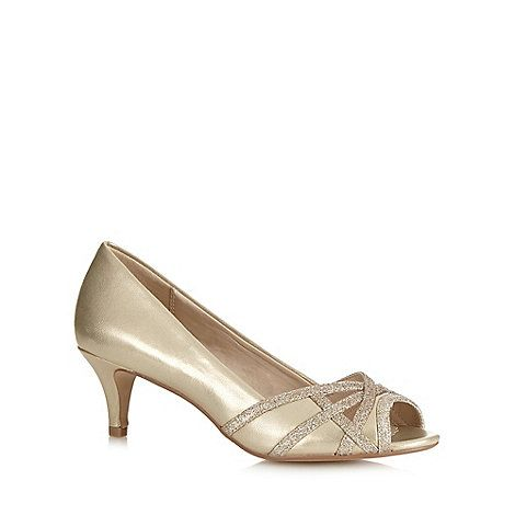 18099f7e8d4 Glam up your evening outfit with these gorgeous peep toe shoes from Debut.  In gold