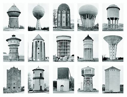 Becher, Bernd und Hilla, Wassertürme/Châteaux d'eau, 1999 at Kunstakademie Düsseldorf. The Becher took pictures like passionate and determined collectors, treating images of water towers, grain elevators, warehouses and other industrial buildings as if they were butterflies that had to be aligned with the utmost care in a catalog. They portrayed the mundane with an unprejudiced and clinical eye.