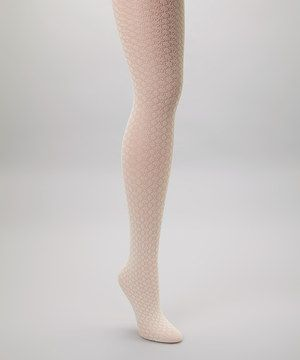 Fabulously funky and oh-so chic, these net tights put the ''P'' in pizzazz. Pair them with ankle boots and a flouncy skirt for an especially fierce look.