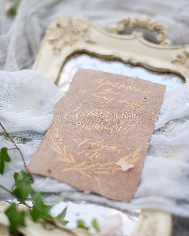 Gold on tan wedding invitations and the bride wears soft illusion capelet wedding dress
