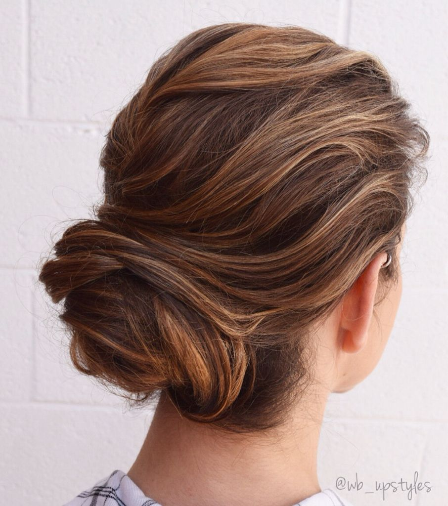 romantic wedding hairstyle. low bun and swept back! | wedding
