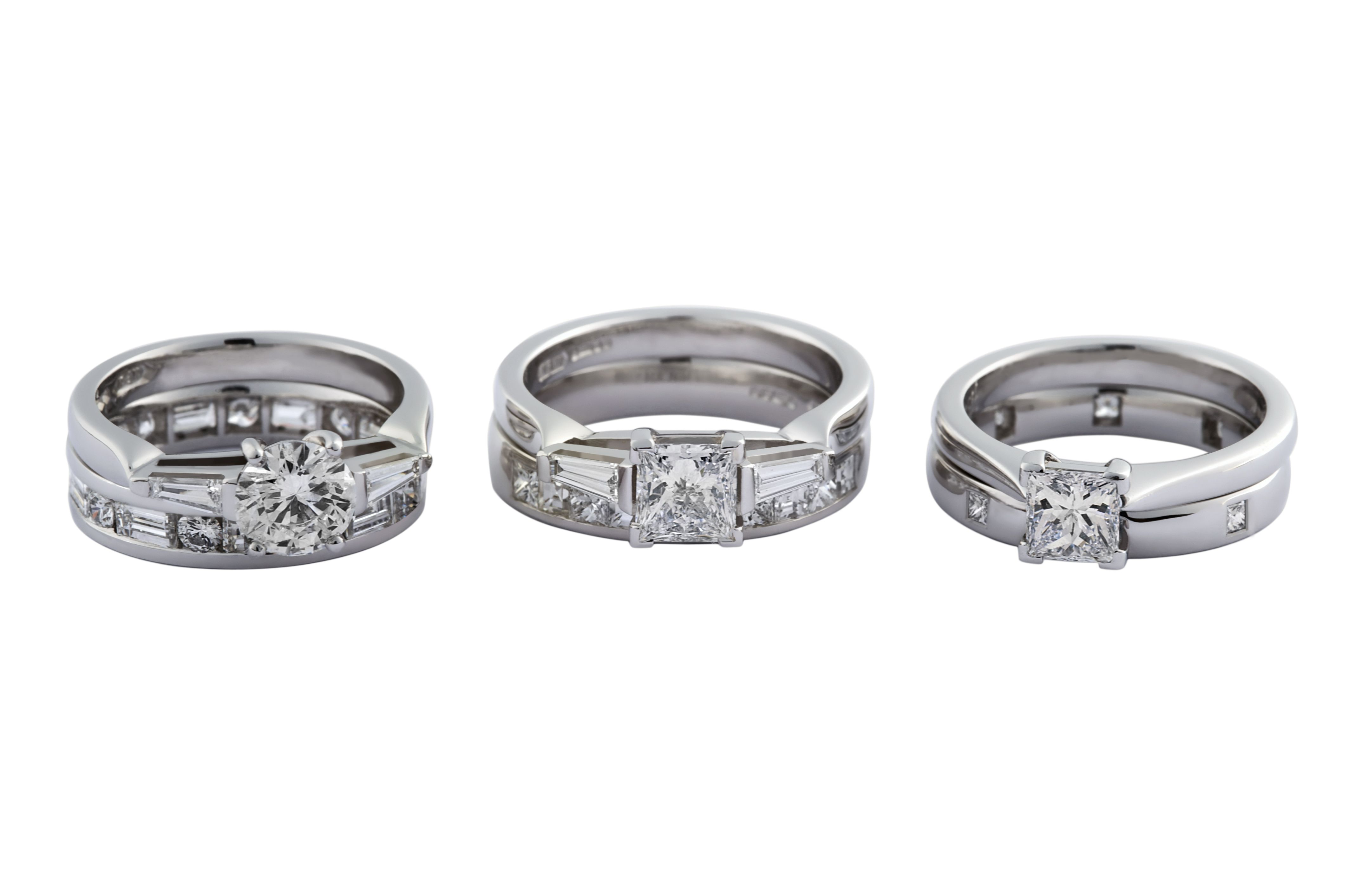 Handmade platinum engagement rings made to sit perfectly next to diamond set wedding bands.