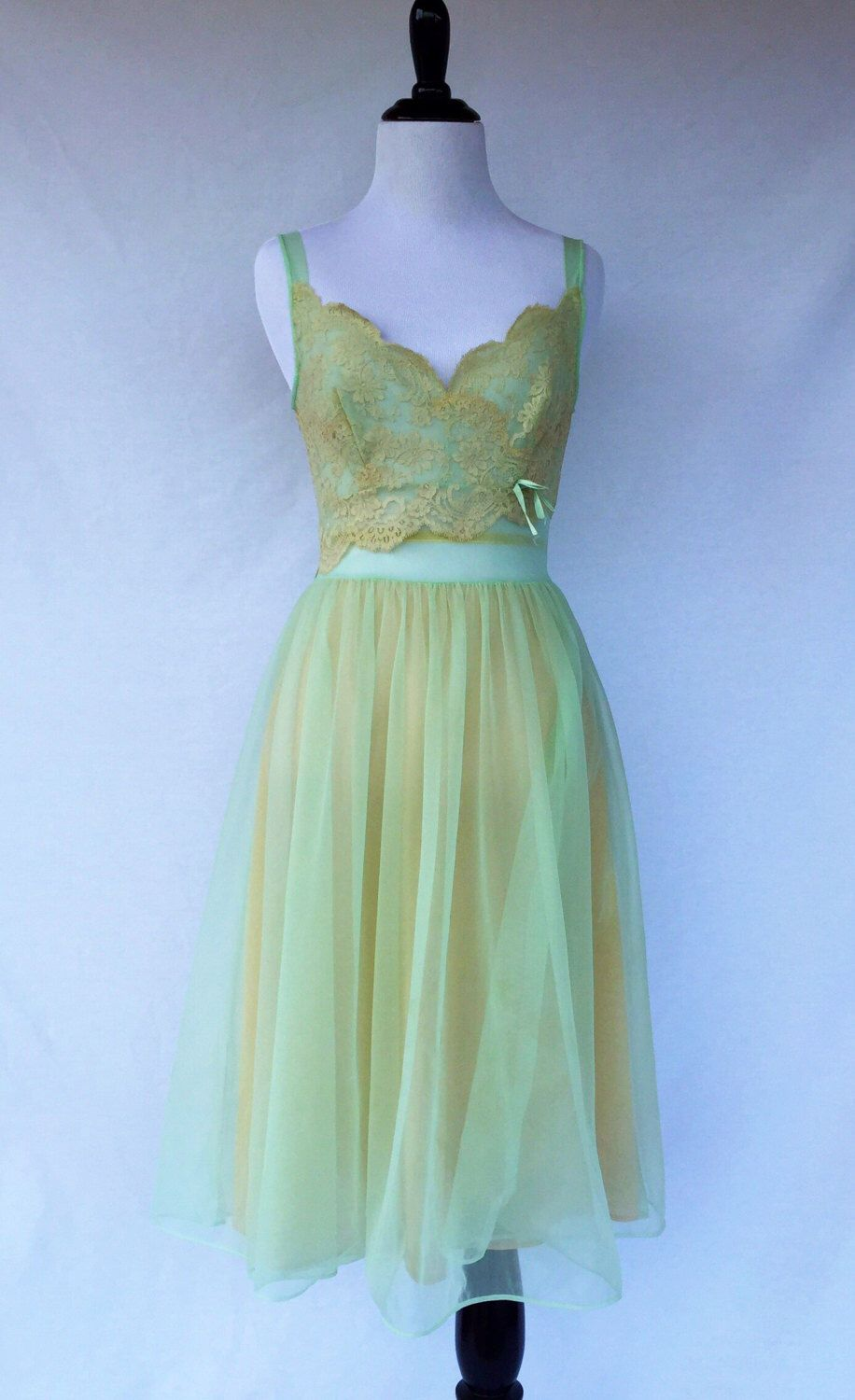 A personal favorite from my Etsy shop https://www.etsy.com/listing/510972847/50s60s-light-green-baby-doll-sheer-and