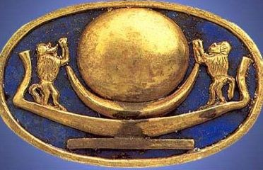 Gold ring with a solar barque flanked by two baboons from the tomb of Tutunkhamun