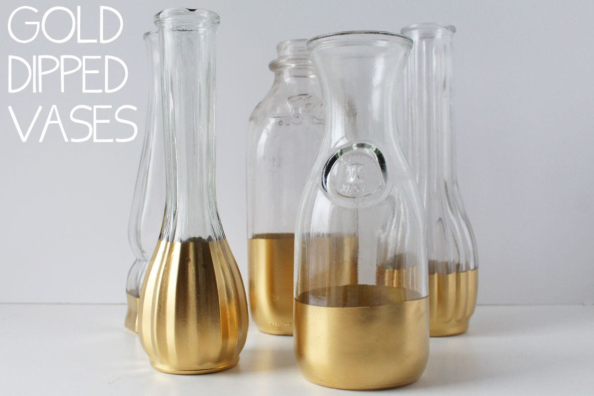 Spray paint metallic base to a glass flower vase or container to diy gold dipped vases for weddings or parties reviewsmspy
