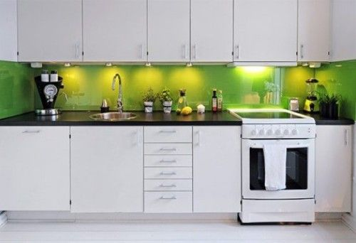 white kitchen accent colors. In an all white kitchen  accessories can add small pops of color