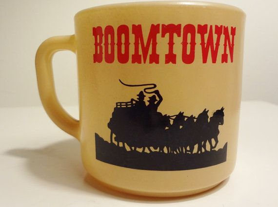 Great coffee mug advertising Renos Boomtown Casino. Its made by Federal Glass, as marked on the bottom. Nice milk glass interior with tan, red