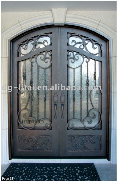 Italian wrought iron front doors wrought iron door grill for Exterior window grill design