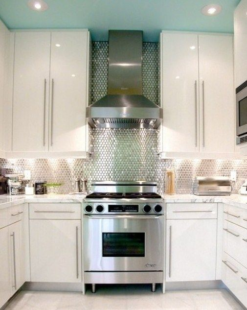 modern kitchen with stainless steel mosaic tile backsplash | love the dreamy turquoise ceiling and that stove!