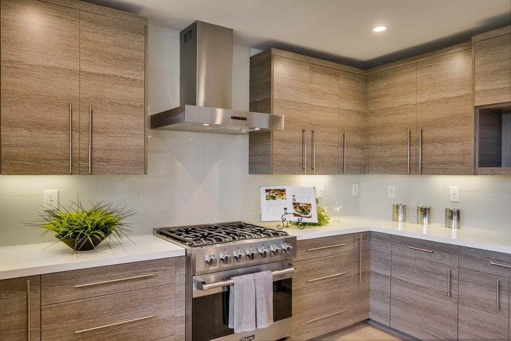 Contemporary Kitchen With Custom Hood Flush Limestone Tile