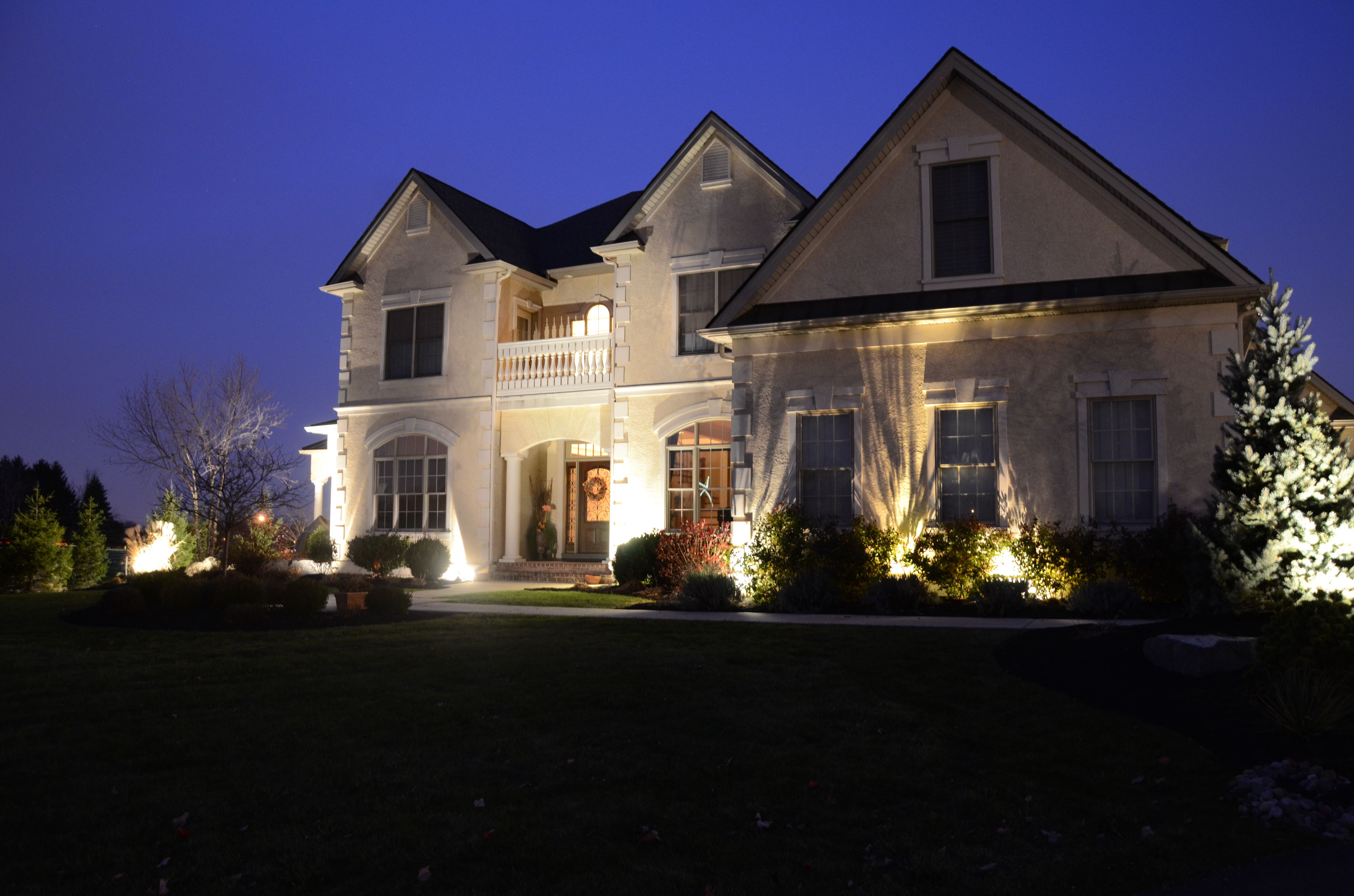 Landscape Lights And Spotlights Showcase This House Hardscape