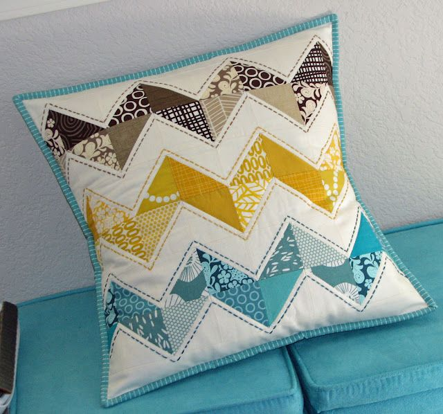 For a blogger's pillow swap, sew-fantastic.blogspot.com, love the colors and the stitching detailed (described further in the blog post)