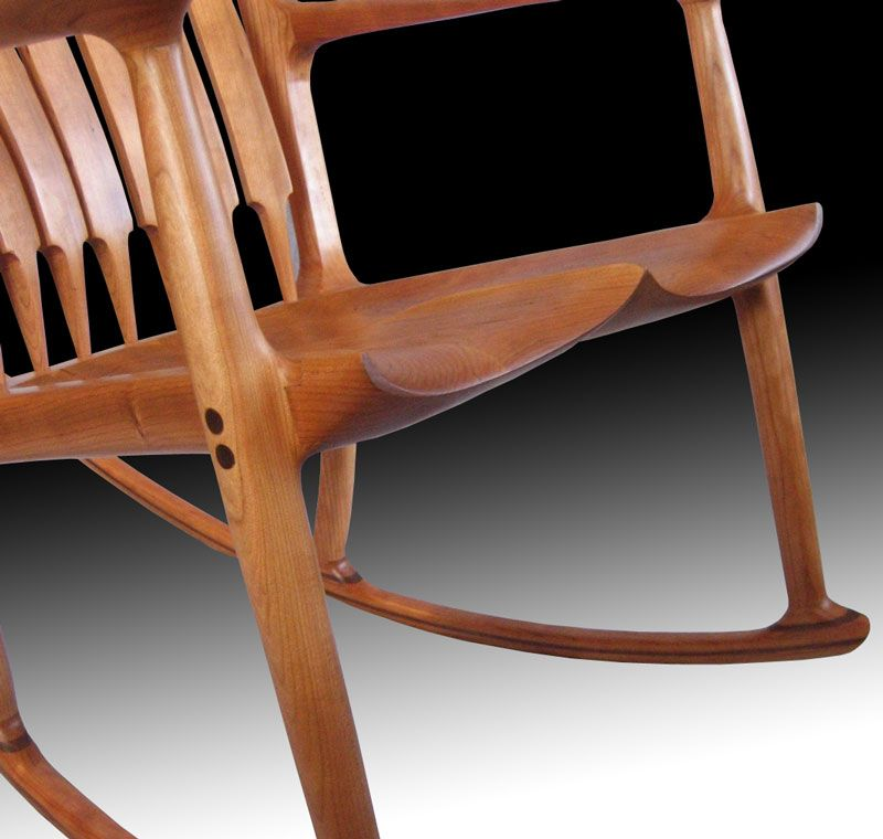 Maloof style rocking chair. Custom rocking chair showing detail of carved seat pommel and transitions