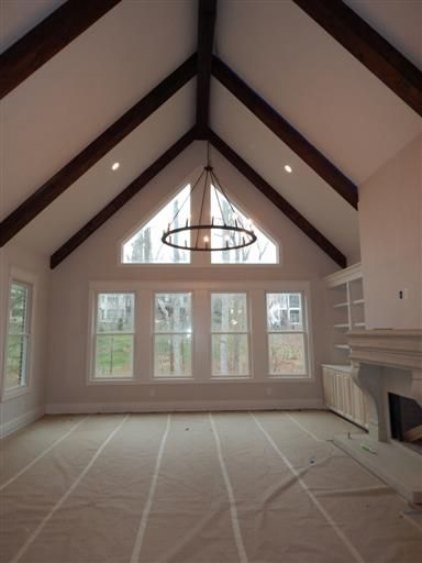 Vaulted Family Room With Stained Cedar Beams And Wall Of