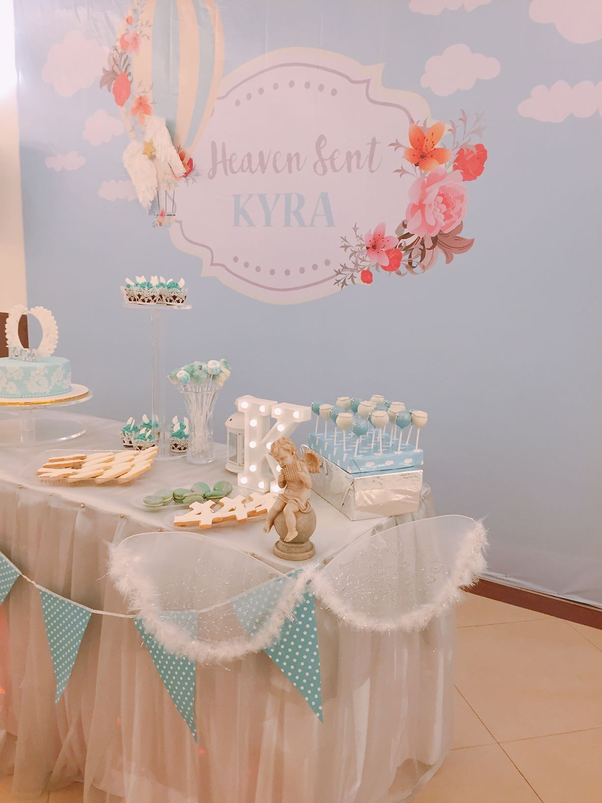 Heaven sent angel backdrop and dessert table