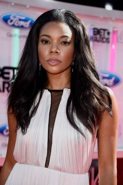 Gabrielle Union with flawless, radiant skin and voluminous hair on June 29.