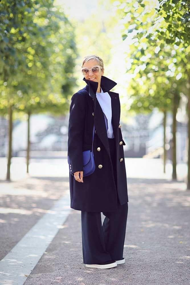 Anne-Marie Curtis, Fashion Director Sacai Luck military coat, Joseph blue cotton shirt, Whistles wide leg trousers, Celine skate shoes and Celine bag, Miu Miu sunglasses. What ELLE Wears, LFW SS 2016 Street Style.