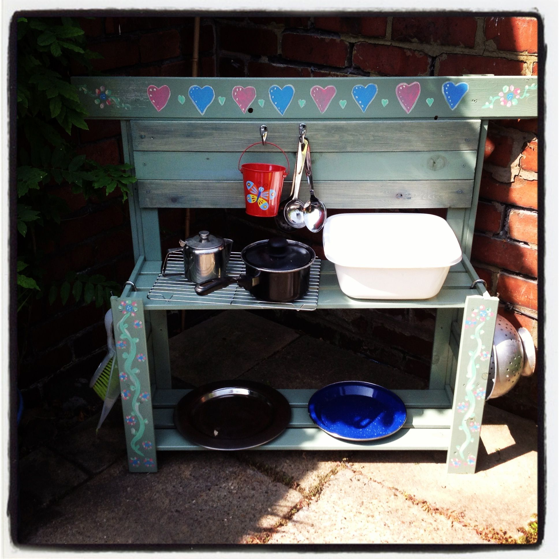 My Children S Outdoor Kitchen Made Out Of An Old Shelving Unit Outdoor Kitchen Shelving Unit Outdoor Kids