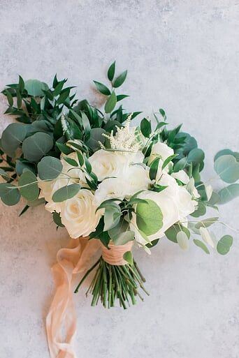 White and green bouquet with draping ribbons. Eucalyptus, roses, astilbe bouquet. Florals by Jenny/ Koman Photography #astilbebouquet White and green bouquet with draping ribbons. Eucalyptus, roses, astilbe bouquet. Florals by Jenny/ Koman Photography