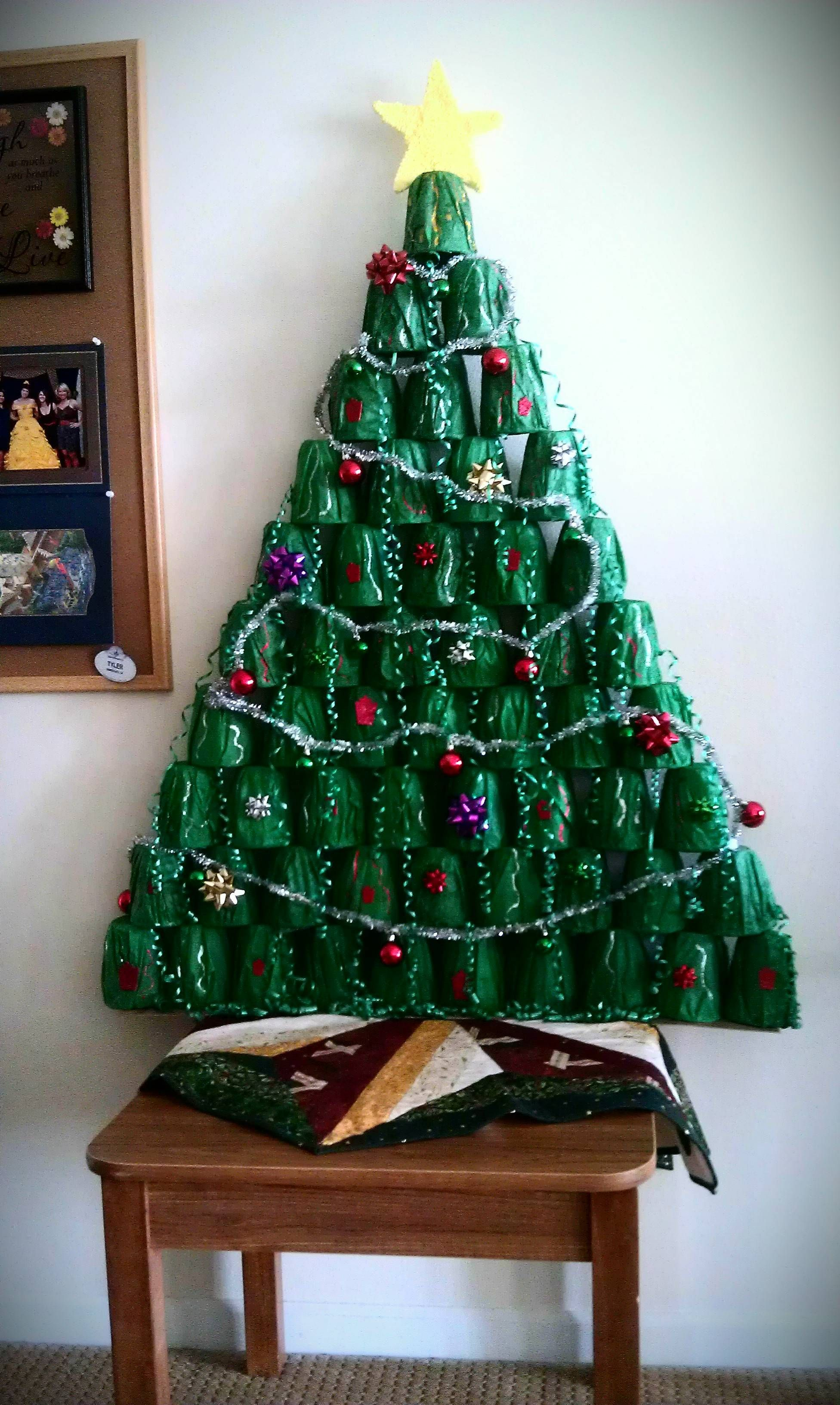 My roomates and I made a Christmas tree out of plastic cups, gift ...