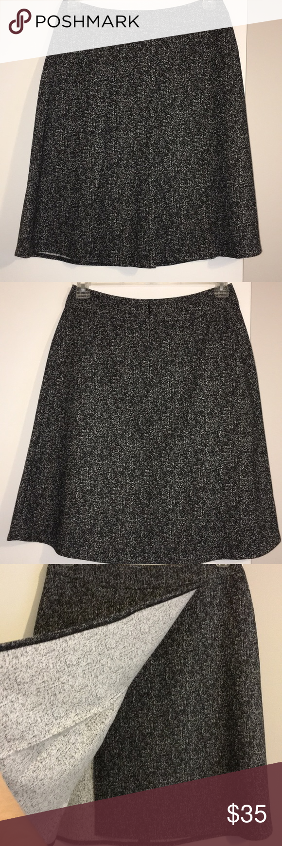 e1a740c0cf0e84 The Limited Faux Wrap Skirt Beautiful black and white tweed looking faux wrap  skirt. Has three pleats in the front and zips in the back.