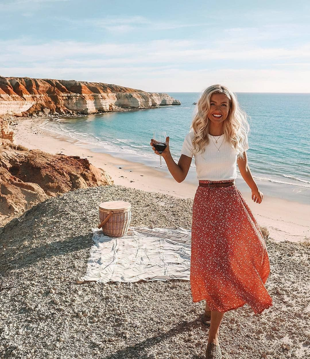 """Fortunate One on Instagram: """"Where the cliffs meet the sea 🌊We're loving how @elisecook styled our Island Love Midi Dress Red as a skirt - perfectly paired with our…"""" 1"""