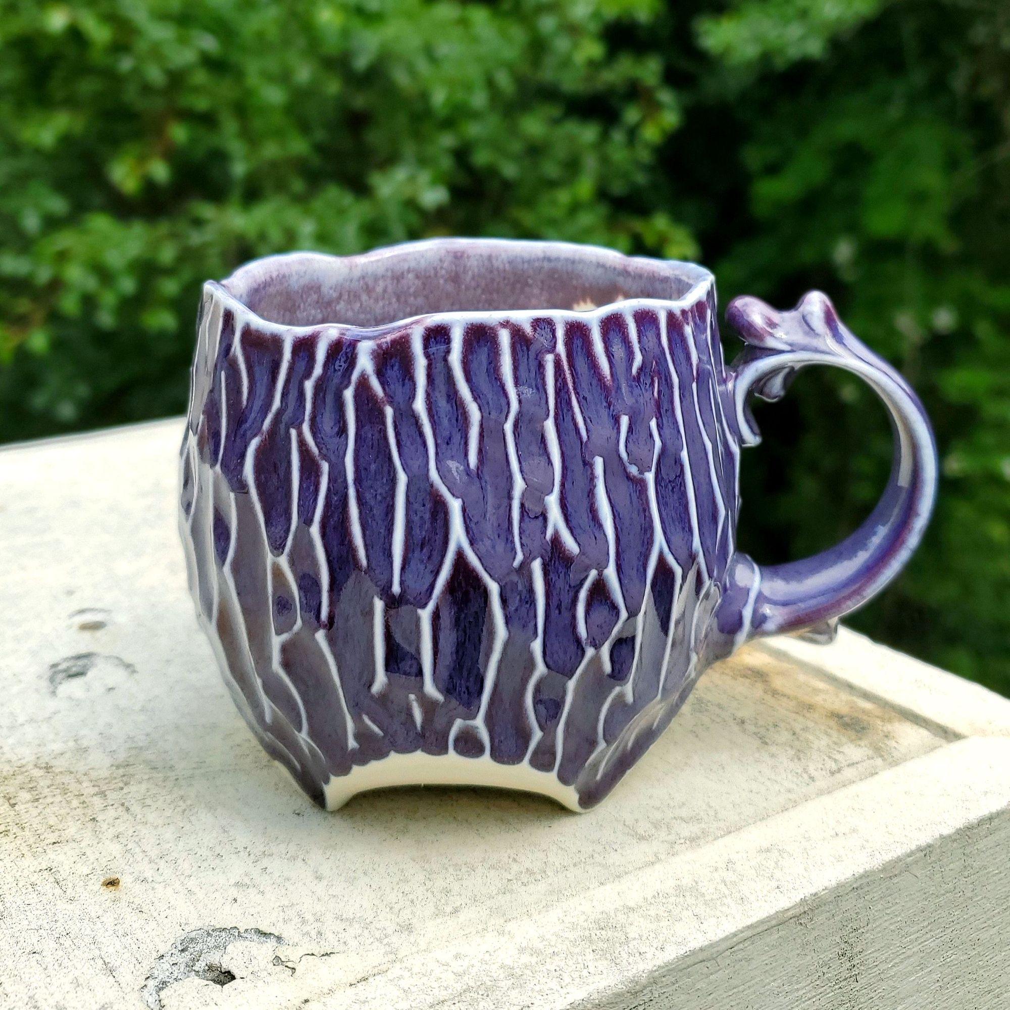 Starting to gather up some finished mugs from my quarantine work-from-home! This mug was approved by my cat, Luna. . . . . .  #kaiceramics #kaitlynchipps #kaitlynceramics #pottery #ceramics #elvish #whimsical #purple #mug #purplemug #kilntotable #fantasy #ceramicart #art #fantasyinspired #femaleartist #potterymagic #elegant #elegance #porcelain #earthy #ethereal #makersgonnamake #pottersofinstagram #potterylife #potterywip #artwip