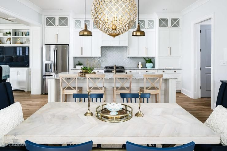 Well Appointed White Kitchen Boasts Light Wood X Back Bar