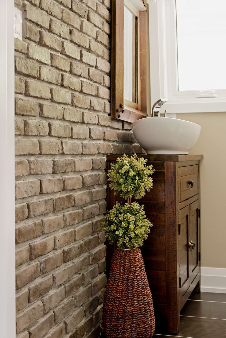Contemporary bathroom with brick accent wall. This look can be easily  achieved with our thin