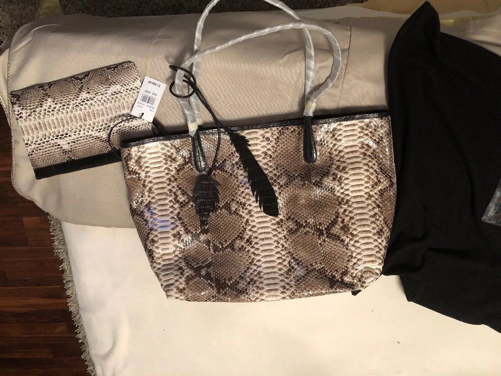 d8668a648ca8 NANCY GONZALEZ New with certificate of authenticity and price tags comes  with dust bag Factory protective