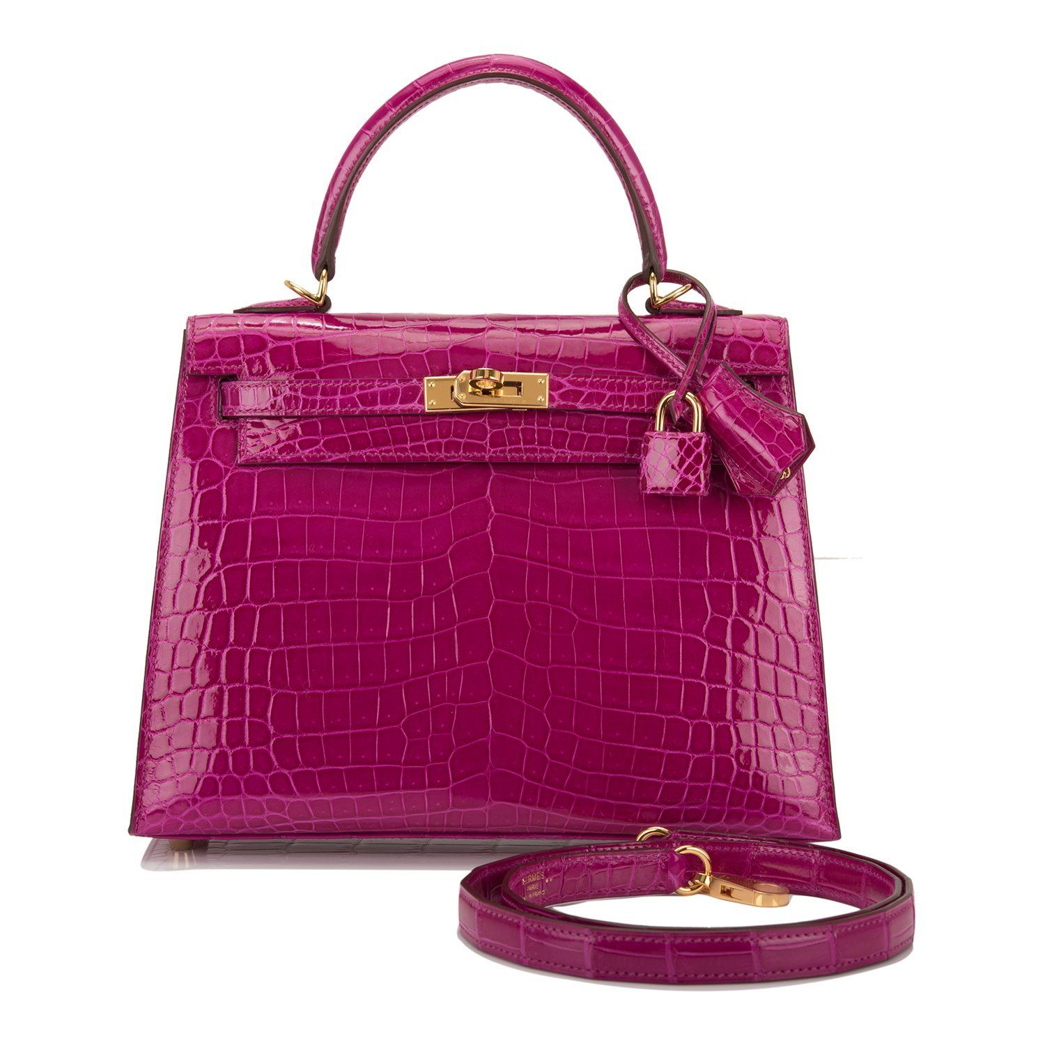 Hermès Kelly 25 Sellier in  Rose Scheherazade  Shiny Niloticus Crocodile  with Gold hardware. Re-sold for  73,000. The bag was made in the Sellier  style in   ... ba7600cf4c