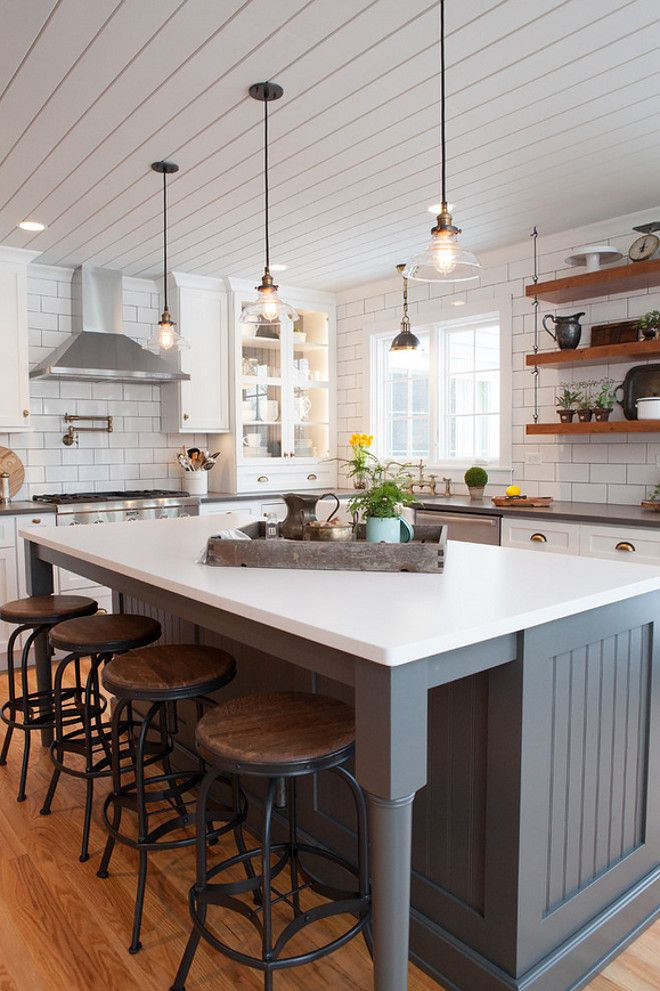 Farmhouse Kitchen With Shiplap Plank Ceiling And Beadboard Island Painted In