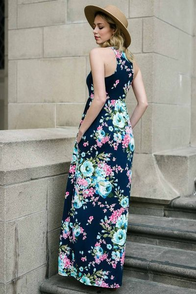 d376bd3c8d6e Floral poly spandex maxi dress with hidden pockets and racer back Perfect  for a beach holiday