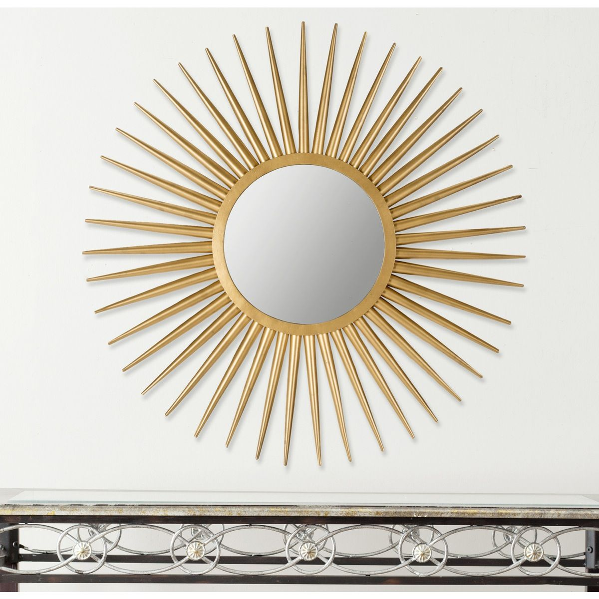 The hand-wrought iron Sun Flair sunburst mirror feels just as at home in traditional décor as it does in midcentury modern. Its elegant artisan-crafted gold finish makes this stunning decorative element shine.