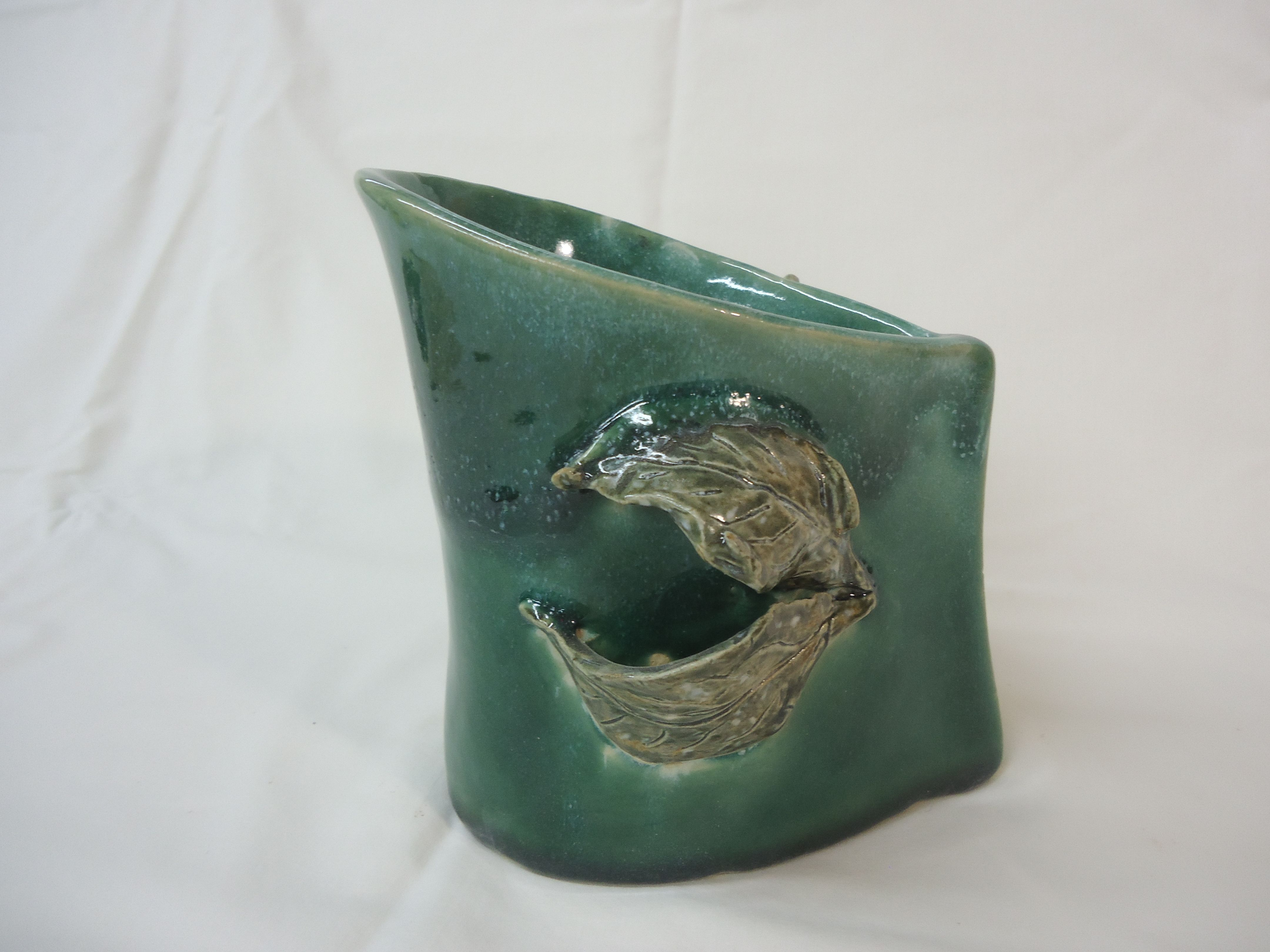 handbuilt large-mouth vase with leaves added