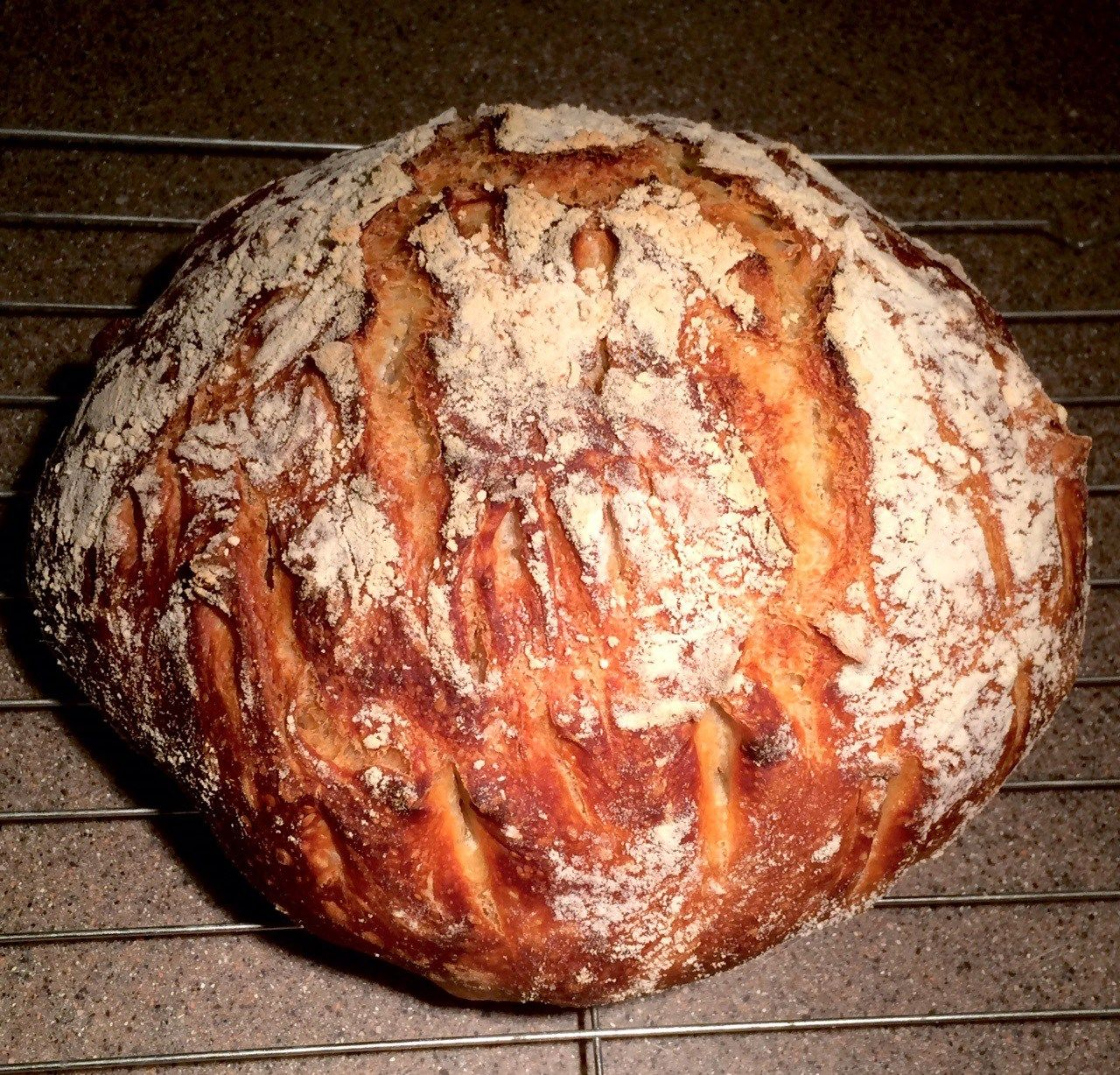Easy home-made Dutch Oven bread recipe for light and airy bread with a golden brown crispy crust. Amazing taste! Small amount of ingredients, easy to make!