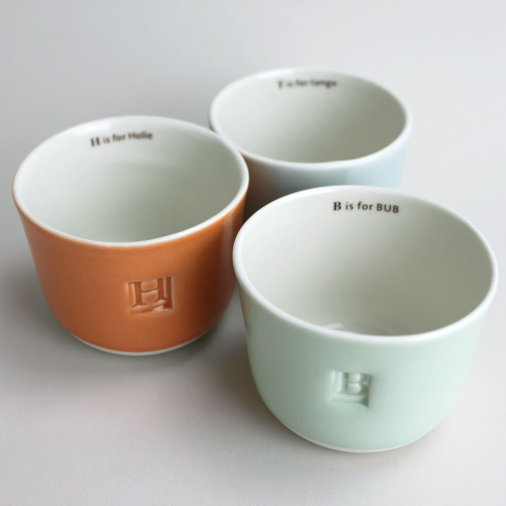 "Made to Order: custom letter and name wee tea cup from www.gleena.com (May have to get an ""H is for Henry"" cup!)"