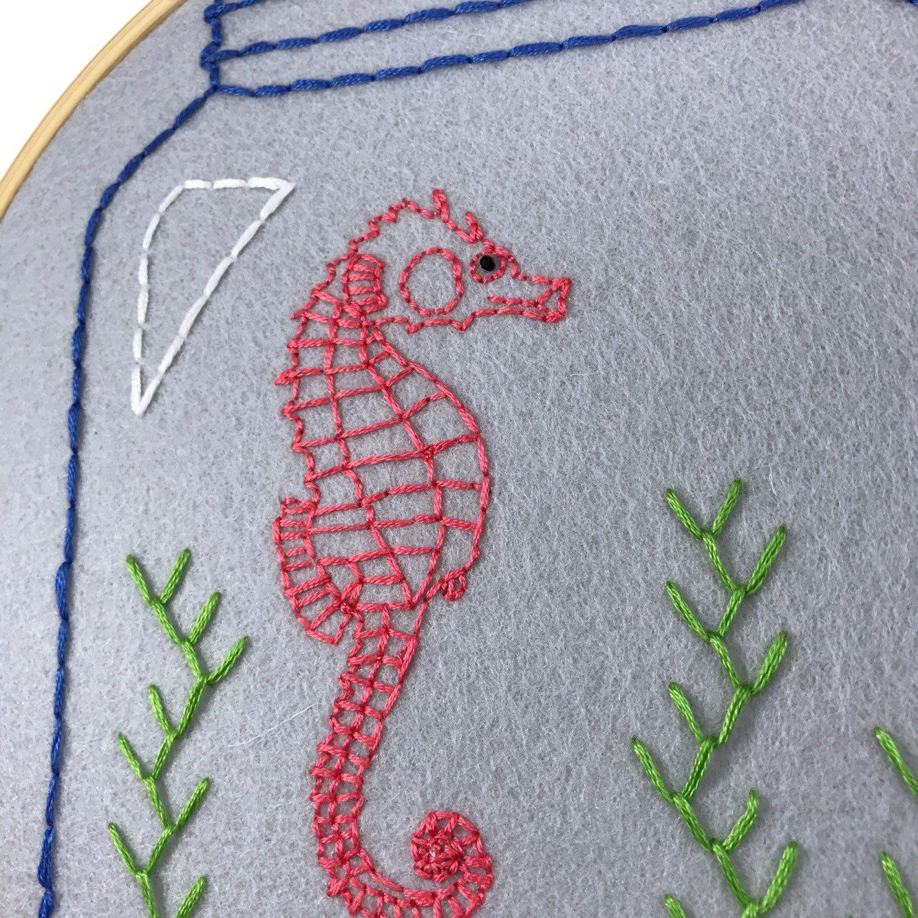 """I stitched this 8"""" hoop up as an example of a pattern in my shop and it's also in my shop as a finished product in the """"hand embroidered art"""" section if you're not embroidery-inclined."""